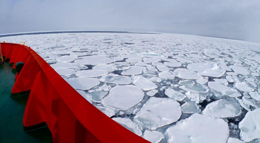 The Aurora Australis breaking up the ice into pancake-like circles